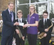 TBSHS Music Department Present Grove Cottage with a cheque